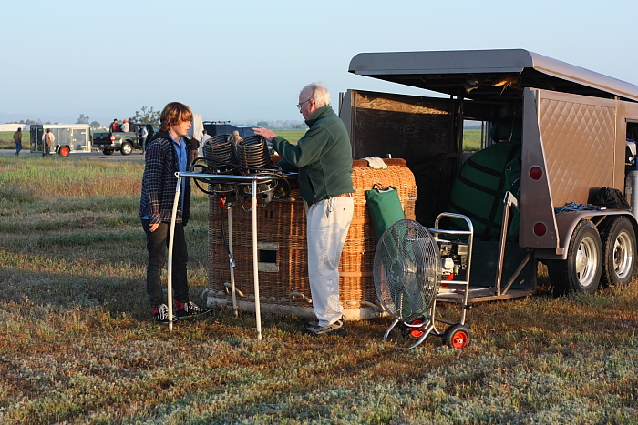 Rick Wallace sets up his hot air balloon with grandson Alex Kinsinger