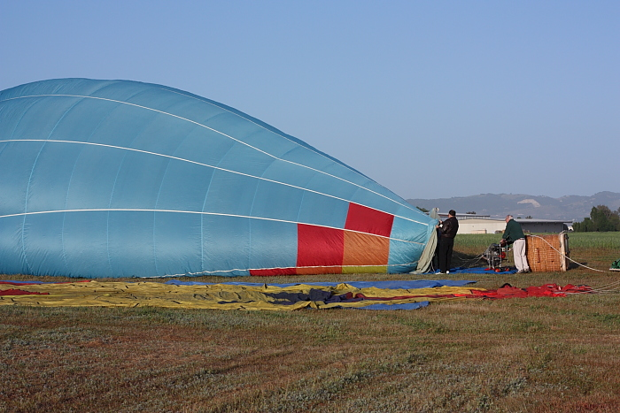 balloon is partially inflated prior to firing burners