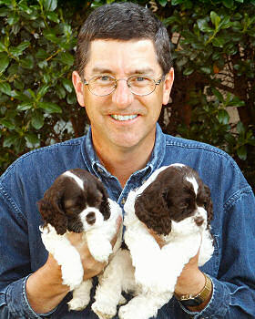 Jim Zim with two chocolate puppies in 2002