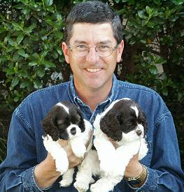 Jim Zim with two chocolate parti puppies