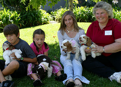 New owners with their Zim puppies