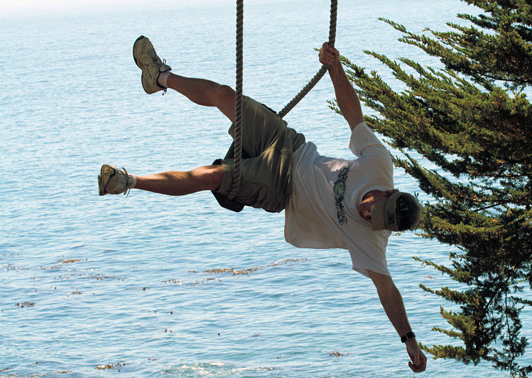 clowning around on a rope swing