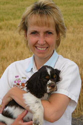 Kellyn and our chocolate tri Cocker puppy