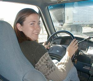 Sheri driving a Ford pickup truck